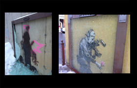 The Banksy at 537 Main Street (left) was completely obliterated by vandal's spray paint. The one at 402 Main sustained cracked glass, but no spray paint damage.
