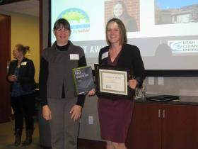 "Kate Bowman, right, being awarded the ""Catalyst Award"" for her leadership and service to advance solar in Utah last fall as an Americorps volunteer."
