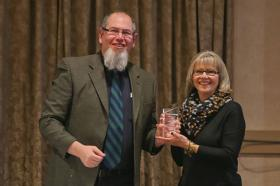 Raelene Davis accepts her award from Martin Griff