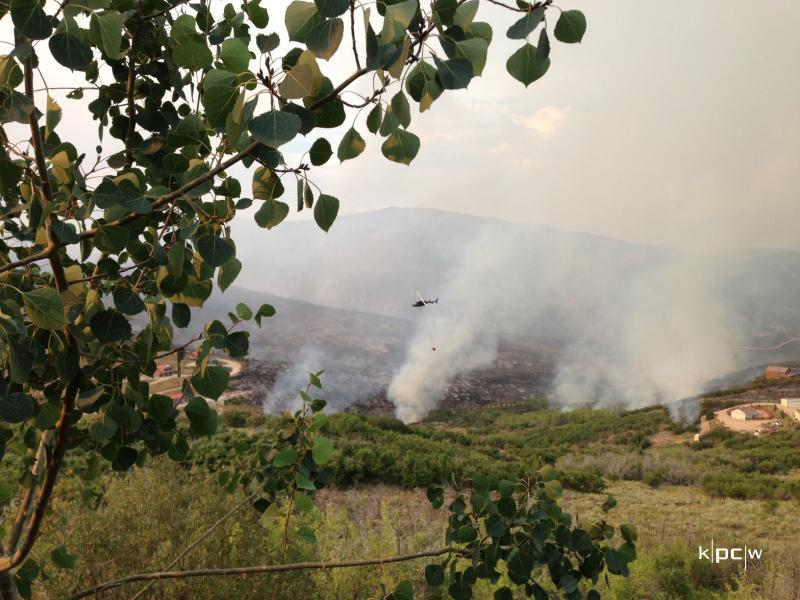 Lynn could actually hear the fire crackling from where she was standing at the NE edge of Promontory. The helicopter dropping fire suppressant hovers over white smoke.