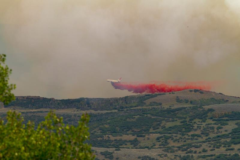 View of the big tanker plane over the Rockport Fire from Tollgate Canyon. Pretty amazing piece of engineering. — at Tollgate Canyon.