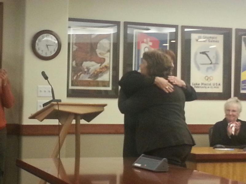Return Park City Council member Cindy Matsumoto gets a hug Judge Shauna Kerr after swearing in for a second term.