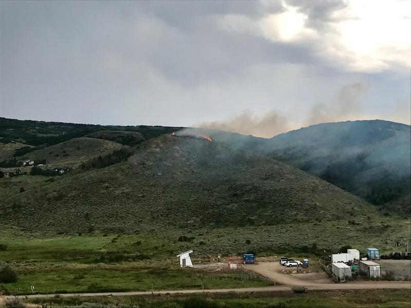 Fifteen firefighters contained the fire on the hill above Jeremy Ranch Elementary  that burned about an acre.
