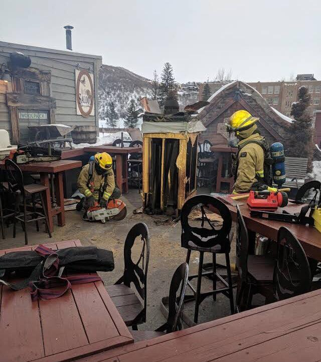 Park City firefighters on the room of the No Name Saloon and Grill on Main Street
