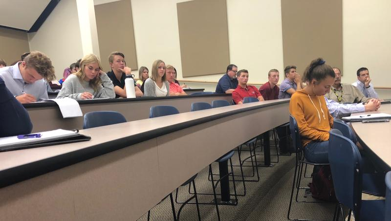 Wasatch High students take notes during Lt. Gov. Spencer Cox presentation to them