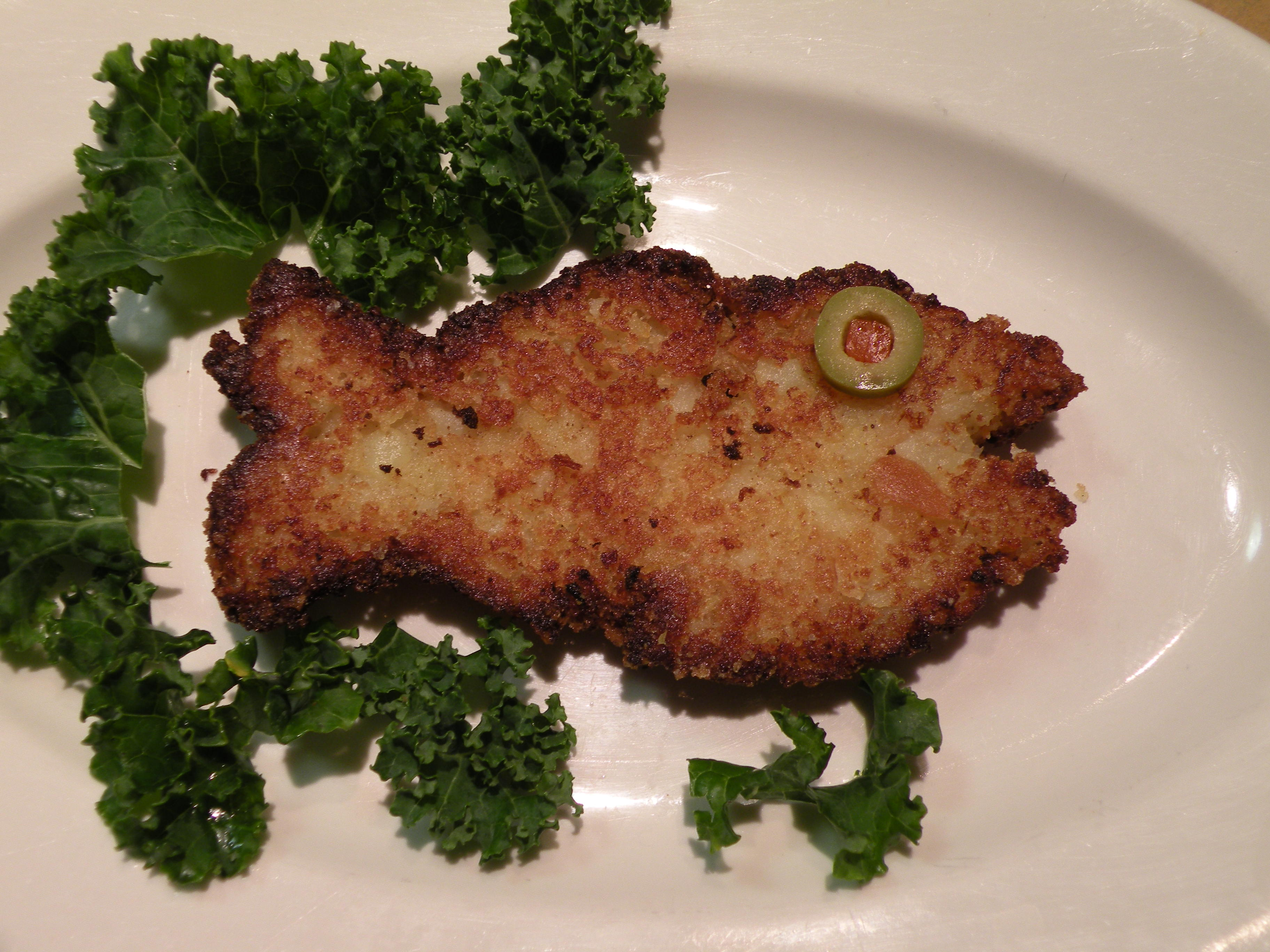 Closure In The Form Of A Fish Shaped Cod Cake With An Olive For Eye