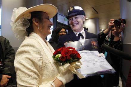 Retired U.S. Coast Guard Petty Officer 1st Class Nancy Monahan, right, wears her dress uniform as she holds her marriage license and stands with her soon-to-be bride Deb Needham as they wait at Seattle City Hall, Sunday, Dec. 9, 2012.