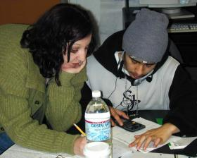 A student gets help with his schoolwork in a Seattle program for at-risk youth