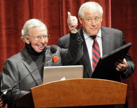 Film Critic Roger Ebert, left, gives a thumbs up to the audience as Illinois Governor Pat Quinn reads a proclamation declaring April 21, 2010 Roger Ebert Day.