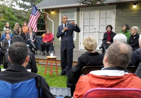 The President speaks Thursday morning in a Wedgwood neighborhood backyard in northeast Seattle.  The conversation: women, jobs and the economy - and the Top Pot Doughnuts Mr. Obama brought with him.