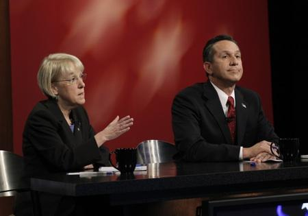 Patty Murray and Dino Rossi are in a tight race. They're shown here at last week's debate in Seattle.