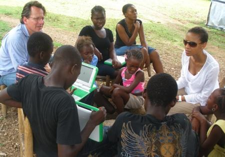 Nicole Matthews (far right) visits an outdoor classroom in Haiti's capital, Port au Prince, in late August, 2010. Matthews teaches at Olympic Middle School in Auburn, Wash.