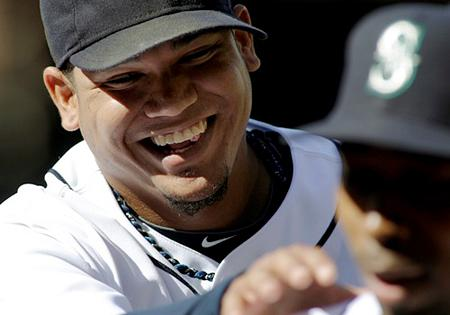 Felix Hernandez, seen here with teammate Chone Figgins in September, has been named the American League's Cy Young Award winner for 2010.