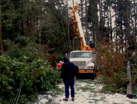 Crews work to fix downed power lines in Kitsap County on Wednesday, Nov. 24, 2010. This photo was shared on Twitter.