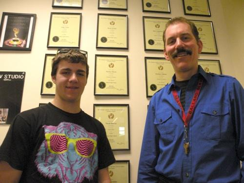 Ballard High has won numerous awards for their video and film productions over the past decade. Here, instructor Matt Lawrence (r) and senior Blair Scott are shown in front of an awards 'wall' at the school.