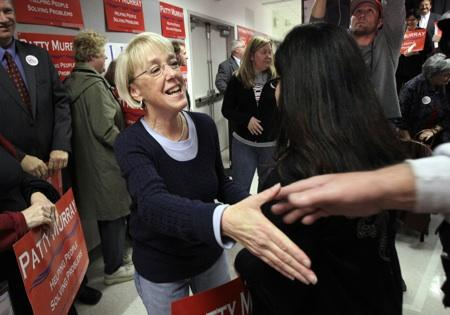 Patty Murray shakes hands with supporters on Monday at the Boeing machinists' union office in Everett, Wash.