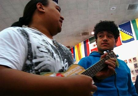 Foster High School students Ryan Javier (l) and Johny Esparza (r). Esparza is part of the ukulele 'fever' spreading at Foster High School. He is Mexican and is learning how to play from his Pacific Islander friends.