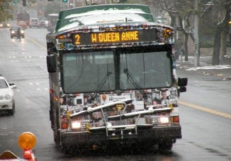 A Metro bus makes its way up 4th Avenue in Seattle's Belltown neighborhood during Monday's snowstorm, Nov. 22, 2010.