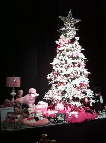"Designer Cindi Sullivan's tree, titled ""OOH LA LA"" features pink poodles and thick flock."