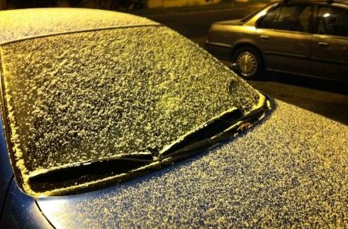Many in western Washington are waking up to a dusting of snow Monday morning. These cars are near downtown Seattle.