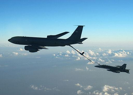 One of the US Airforce's  aging KC-135 tankers refuels an F-18 Hornet midflight.  The contract to replace the US fleet of refuelling tankers is estimated to be worth $40  B.