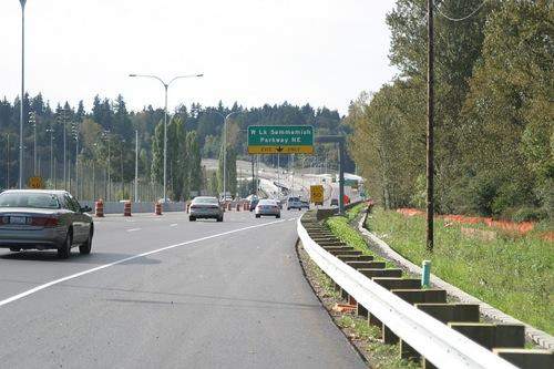 Improvements to Highway 520 through Redmond could cut commute times by 15 minutes or more, according to state transportation leaders. The new roads opened officially Wednesday morning.