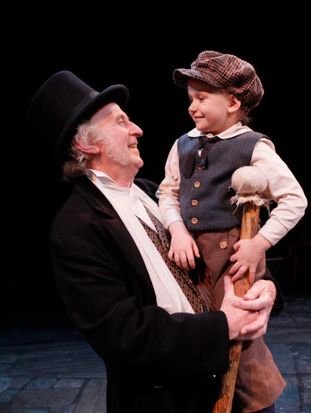 "Sean G. Griffin as Scrooge and Sarah Roberts as Tiny Tim in ACT's ""A Christmas Carol."""
