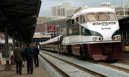 An Amtrak Cascades train pulls into Seattle in this AP file photo. A federal diversion of transportation funds aimed at high-speed rail projects are giving a big boost to Washington State.