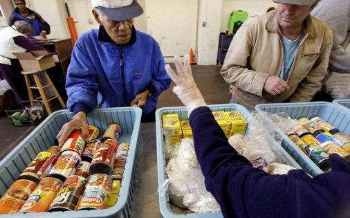 A food bank operated by Northwest Harvest in Seattle. As more strapped Americans rely on charity amid worsening economic gloom, operators of food banks and other charities are relying on the surprisingly resilient generosity of their neighbors.