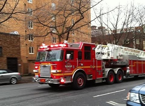 A Seattle Fire Department ladder unit responds to an emergency in the Belltown neighborhood last week. The state is getting kudos for its overall emergency and disaster response efforts in protecting public health.