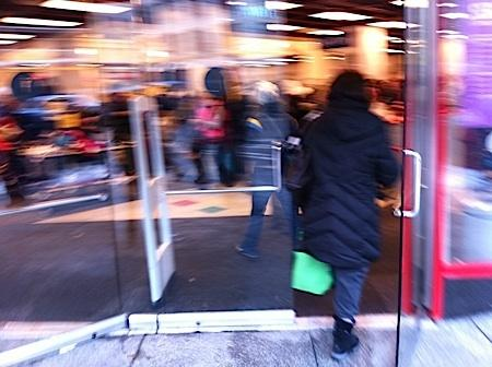 A shopper enters Nordstrom Rack in downtown Seattle as the holiday shopping season began in late November.