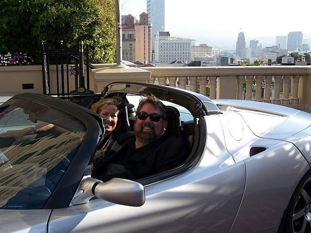 Mark Anderson and Sharon Anderson Morris test drive a Tesla Roadster