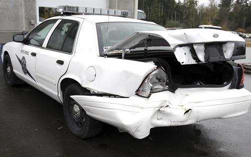 This Washington State Patrol car was smashed while responding to a roadside incident.