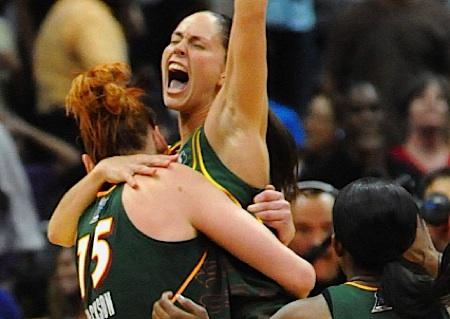 Seattle Storm stars Lauren Jackson (left) and Sue Bird (right) celebrate after helping lead the team to its second WNBA title, defeating the Atlanta Dream.