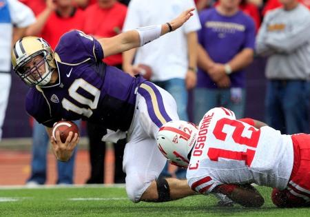 UW quarterback Jake Locker is tackled during a game against Nebraska at Husky Stadium on Sept. 18, 2010.  Washington lost 56-21.