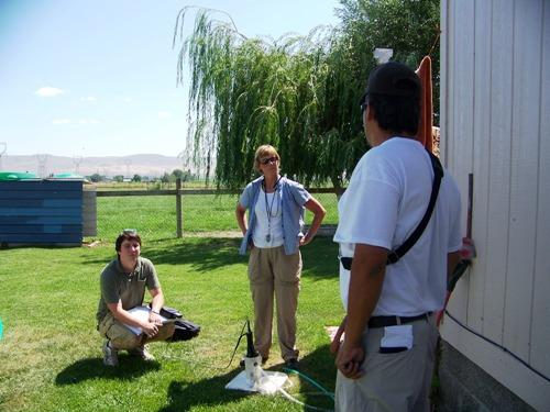 Sandy Halstead, of the Environmental Protection Agency, and a summer intern, listen to the concerns of a homeowner in the Yakima Valley. Many private wells in the Eastern Washington agricultural area are polluted with nitrates.