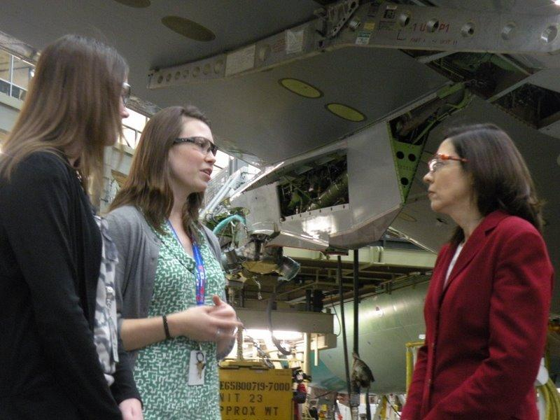 U.S. Sen. Maria Cantwell, D-Wash., (right) talks with Boeing 767 employees Anna Karsky (left) and Maeghan Smith Hudon below the wing of a 767 at Boeing's plant in Everett.