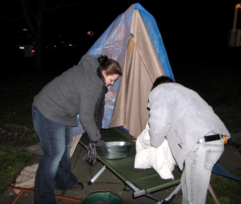 UW Tacoma students practice setting up a simulation of a refugee shelter in Haiti. The students will put the replica dwellings and an aid tent in the middle of campus on the one-year anniversary of the earthquake.