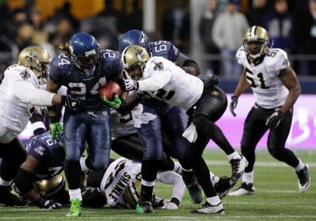 Seattle running back Marshawn Lynch breaks through the New Orleans defensive line on way to a 67-yard touchdown run late in the 4th quarter on Saturday. Seattle pulled a major upset in defeating the Saints at Qwest Field in an NFC wildcard playoff