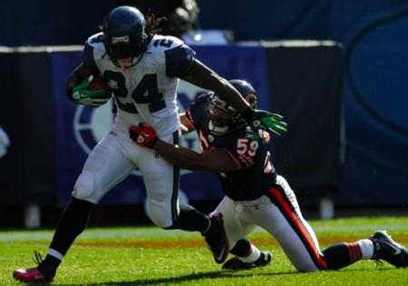 Seattle Seahawks running back Marshawn Lynch, left, carries the ball as Chicago Bears linebacker Pisa Tinoisamoa tries to make the tackle during a regular season game in Chicago, Oct. 17, 2010. Seattle won 23-20. Can Lynch and the 'Hawks win there again?