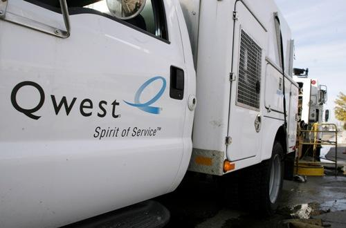 The Qwest company logo adorns the side of a repair truck.  CenturyLink appears likely to gain cleareance to take over Qwest.