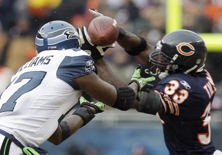 Chicago Bears cornerback Charles Tillman (33) breaks up a pass intended for Seattle Seahawks' Mike Williams (17) during the second half of an NFL divisional playoff game Sunday, Jan. 16, 2011, in Chicago. The Bears beat the Seahawks 35-24.