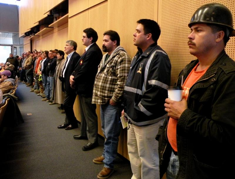 Dozens of Port of Seattle and construction workers filled a city council meeting to support the replacement of the Alaskan Way Viaduct with a deep bored tunnel