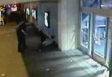 Grainy surveillance video captures the moment a King County Sheriff's deputy, working with Metro Transit police, knocks Christopher Harris against an outside wall of the Cinerama Theater in Seattle's Belltown neighborhood in May 2009.