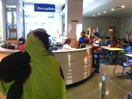 Parents and their kids line-up for registration at Seattle School District headquarters last June, prior to the school year.