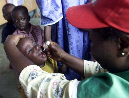 A Nigerian child receives drops of polio vaccine at the Ore-Ofe nursery school in Lagos, Nigeria, in 2003.