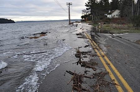 "A view of Olympiad Drive in Southworth on the Kitsap Peninsula during a January ""king tide"" from the state Dept. of Ecology's Flickr photo page."