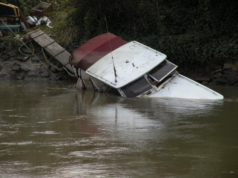 This adandoned boat sank in the Duwamish River in Tukwila about two months ago. DNR says the city is going through the required process of trying to notify the boat's owner. If the owner doesn't deal with the boat by mid-February, the city will take over.