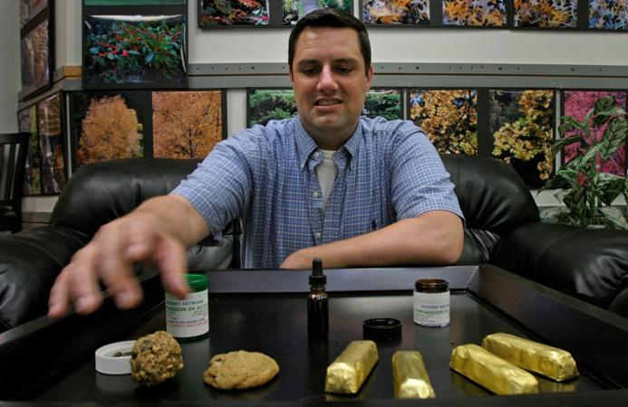 Dale Rogers displays different types of marijuana available at the Compassion in Action Patient Network, an organization that distributes medical marijuana to qualifying patients in June 2007 in Seattle. Rogers has been diagnosed with AIDS about 20 years.