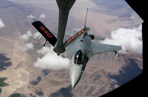 An F-16 from the California Air National Guard's 144th Fighter Wing aligns with the boom from a Boeing, KC-135 Stratotanker.